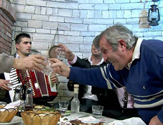 Toast with raki in the tradition of Skrapar